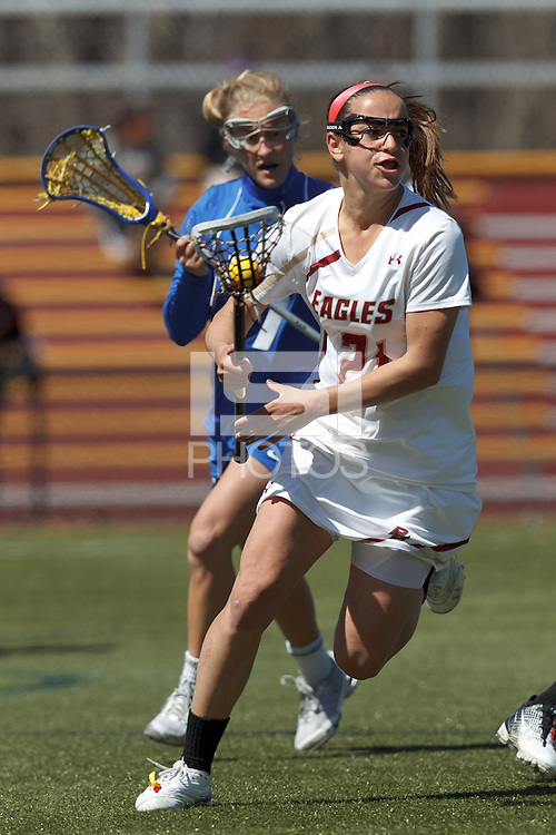Boston College midfielder Caroline Margolis (21) regroups after a drive to the net.Boston College (white) defeated Duke University (blue), 10-9, on the Newton Campus Lacrosse Field at Boston College, on April 6, 2013.