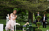 "First lady Melania Trump reads ""Party Animals"" by Kathie Lee Gifford to a group of children as she and United States President Donald J. Trump host the annual Easter Egg Roll on the South Lawn of the White House in Washington, DC on Monday, April 17, 2017.<br /> Credit: Olivier Douliery / Pool via CNP"