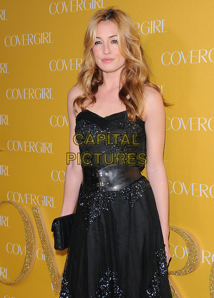 CAT DEELEY.The Covergirl 50th Anniversary Celebration held at BOA in West Hollywood, California, USA..January 5th, 2011 .half length black belt sheer tulle beads beaded dress clutch bag strapless.CAP/RKE/DVS.©DVS/RockinExposures/Capital Pictures.