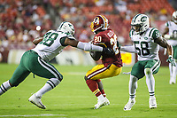 Landover, MD - August 16, 2018: Washington Redskins running back Rob is tackled by several New York Jets defenders during the preseason game between New York Jets and Washington Redskins at FedEx Field in Landover, MD.   (Photo by Elliott Brown/Media Images International)