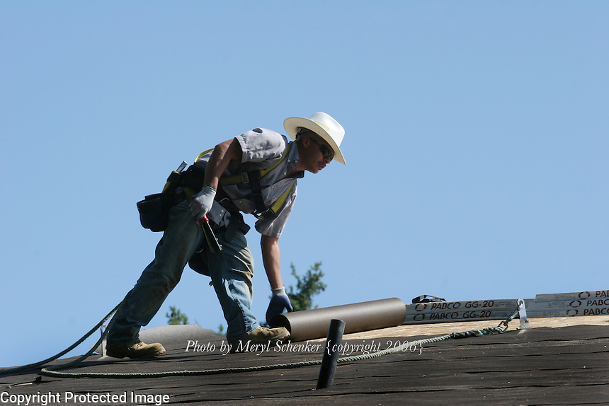 Jesus Benitez works on the roof of a new Quadrant Home in Mt. Vernon, Washington on August 4, 2006.