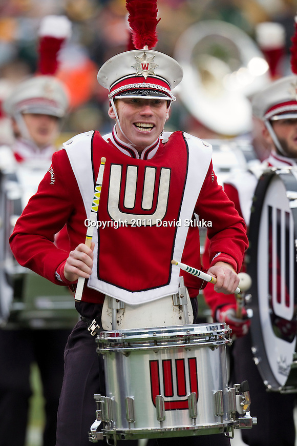 A Wisconsin Badgers band member plays the drum halftime of the Green Bay Packers Week 11 NFL football game against the Tampa Bay Buccaneers on November 20, 2011 in Green Bay, Wisconsin. The Packers won 35-26. (AP Photo/David Stluka)