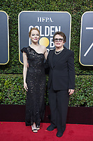 Emma Stone, nominated for BEST PERFORMANCE BY AN ACTRESS IN A MOTION PICTURE &ndash; COMEDY OR MUSICAL for her role in &quot;Battle of the Sexes,&quot; and Billie Jean King arrive at the 75th Annual Golden Globe Awards at the Beverly Hilton in Beverly Hills, CA on Sunday, January 7, 2018.<br /> *Editorial Use Only*<br /> CAP/PLF/HFPA<br /> &copy;HFPA/PLF/Capital Pictures
