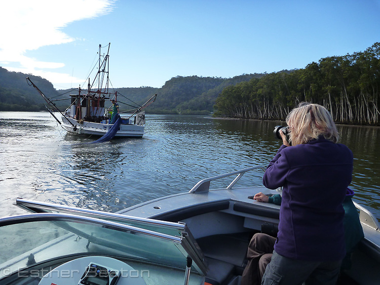 Esther Beaton photographing while on assignment for HNCMA on Hawkesbury River, New South Wales