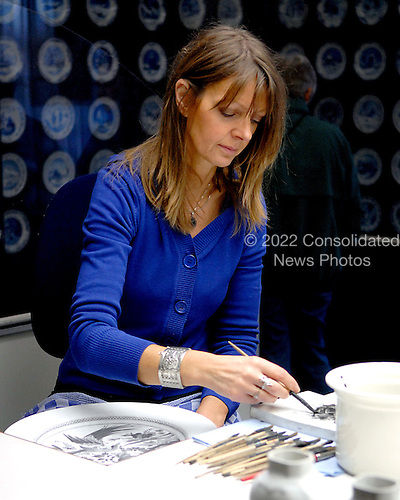 Delft, Netherlands - November 5, 2007 -- An artisan works on a plate at the Royal Delft factory in Delft, Netherlands on Monday, November 5, 2007.  Delftware, the distinctive Dutch blue and white pottery, is produced in this factory..Credit: Ron Sachs / CNP