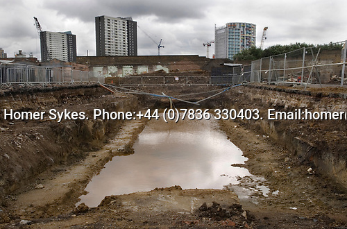 East London Lea Valley  site of the 2012 Olympic Games village and arena, Stratford, England 2007. Aquatic Centre site off Carpenters Road. An archeological dig site. Background  Stratford tower blocks.