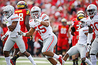 Ohio State Buckeyes linebacker Camren Williams (55) celebrates a tackle during the first quarter of the NCAA football game at Byrd Stadium in College Park, Maryland on Oct. 4, 2014. (Adam Cairns / The Columbus Dispatch)