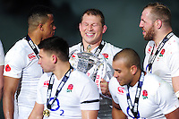 Dylan Hartley of England is all smiles with the Six Nations trophy after the match. RBS Six Nations match between France and England on March 19, 2016 at the Stade de France in Paris, France. Photo by: Patrick Khachfe / Onside Images