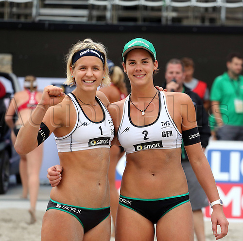 08.08.2013, Berlin, Germany.  Sarah Ludwig ger and Kira Walkenhorst ger celebrate after their Game and Victory at the Berlin Smart Grand Slam Beach volleyball Beach volleyball Grand Slam Tournament Tournament FIVB Forest stage