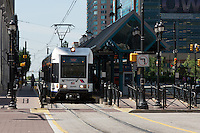 A New Jersey Transit Hudson–Bergen Light Rail (HBLR) train at Exchange Place Station, Jersey City, New Jersey