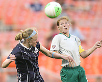 Becky Sauerbrunn #22 of the Washington Freedom goes for a header with Lori Chalupny #17 of St. Louis Athletica during a WPS match on May 1 2010, at RFK Stadium, in Washington D.C. Freedom won 3-1.