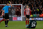 Luke Freeman of Sheffield United is shown a yellow card during the Premier League match at Bramall Lane, Sheffield. Picture date: 5th December 2019. Picture credit should read: James Wilson/Sportimage