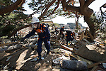 Police search through the rubble for people still missing following the March 11 magnitude 9 quake and subsequent tsunami in the grounds of Jodo-ji temple in Rikuzentakata, Iwate Prefecture, Japan on April 6, 2011..Photographer: Robert Gilhooly