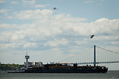 Space shuttle Enterprise, mounted atop a NASA 747 Shuttle Carrier Aircraft (SCA), is seen as it flies over the Verrazano Bridge, Friday, April 27, 2012, in New York. Enterprise was the first shuttle orbiter built for NASA performing test flights in the atmosphere and was incapable of spaceflight. Originally housed at the Smithsonian's Steven F. Udvar-Hazy Center, Enterprise will be demated from the SCA and placed on a barge that will eventually be moved by tugboat up the Hudson River to the Intrepid Sea, Air & Space Museum in June. .Mandatory Credit: Bill Ingalls / NASA via CNP