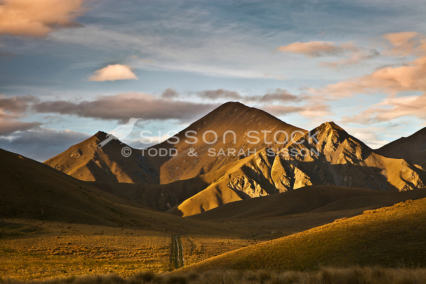 Side lit hills of Lindis Pass at sunset, summer, Central Otago
