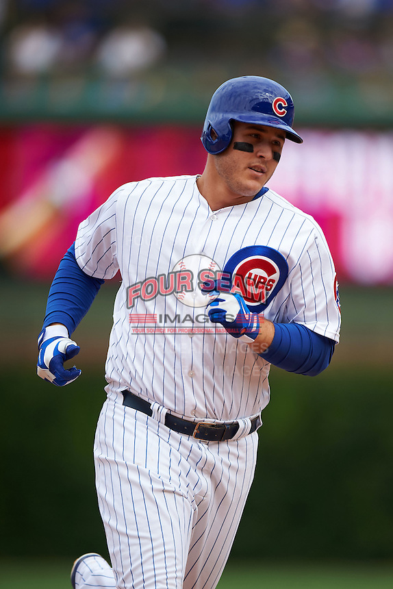Chicago Cubs first baseman Anthony Rizzo (44) runs the bases after hitting a home run during a game against the Milwaukee Brewers on August 13, 2015 at Wrigley Field in Chicago, Illinois.  Chicago defeated Milwaukee 9-2.  (Mike Janes/Four Seam Images)