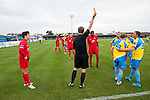 Canvey Island 1 Harrow Borough 0, 17/10/2015. The Frost Financial Stadium, Ryman Premier League. <br /> Harrison Chatting is shown a yellow card late in the game. Canvey Island in yellow played host to Harrow Borough in red in a Ryman Premier League match. The match was won by the home side by 1 goal to 0 and was watched by a crowd of 333. Canvey Island play at their home matches at The Frost Financial Stadium or Park Lane. The ground is a few feet below sea level, making it one of the only football stadiums in the UK to be as such. The ground has a capacity of over 4,500 and the stadium has reached its capacity on one occasion, when the team faced Northampton Town in the FA Cup in 2001. Photo by Simon Gill