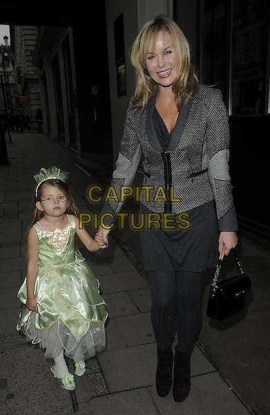 "AMANDA HOLDEN & HER DAUGHTER LEXI .At ""The Princess And The Frog"" Gala Screening, Mayfair Hotel, London, England, UK, January 24th 2010..full length fairy costume dress disney outfit family child kid grey gray jacket black ankle boots tights bag holding hands mom mum mother  glasses .CAP/CAN.©Can Nguyen/Capital Pictures"