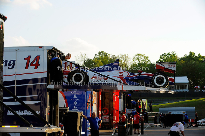 Teams load up and move out as the sun sets over the paddock of Barber Motorsports Park.