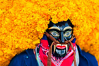 A Mexican man, wearing a black wooden mask with marigold flowers, takes part in the Day of the Dead festivities in Mexico City, Mexico, 29 October 2016. Day of the Dead (Día de Muertos), a syncretic religious holiday combining the death veneration rituals of the ancient Aztec culture with the Catholic practice, is celebrated throughout all Mexico. Based on the belief that the souls of the departed may come back to this world on that day, people gather at the gravesites in cemeteries praying, drinking and playing music, to joyfully remember friends or family members who have died and to support their souls on the spiritual journey.