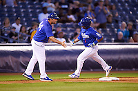 Tulsa Drillers second baseman Willie Calhoun (1) is congratulated by manager Ryan Garko (44) after hitting a home run during a game against the Arkansas Travelers on April 25, 2016 at ONEOK Field in Tulsa, Oklahoma.  Tulsa defeated Arkansas 4-3.  (Mike Janes/Four Seam Images)