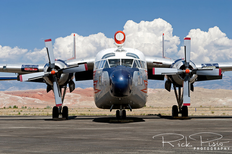 Hawkins and Powers C-119G Flying Boxcar N8093 on the tarmac in Greybull, Wyoming. In August of 2006 all of the remaining Hawkins and Powers assets were auctioned off.<br /> <br /> Built in 1953 for the Royal Canadian Air Force (serial 22111) N8093 kept the basic RCAF color scheme throughout her post military career as a fire tanker. Retired from firefighting duties in 1987 the C-119G was flown to her birthplace in Hagerstown, Maryland in in November of 2008 to be placed in the Hagerstown Aviation Museum.<br /> <br /> The C-119 made its initial flight in November of 1947 and by the time production ceased in 1955 more than 1,100 of the type had been built. Nicknamed the &quot;flying boxcar&quot; for its cargo hauling ability the C-119 was designed to carry cargo, personnel, litter patients, and mechanized equipment.