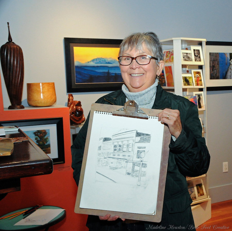 Artist Jeanne Hamilton shows work created during the urban sketch crawl at the Rectangle Gallery during Centralia, Washington's Third Thursday on October 20, 2016.