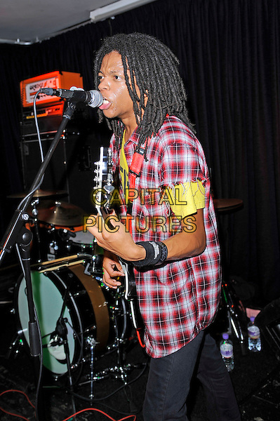 Dee Radke of Radkey <br /> performing in concert, The Blackeart, Camden, London, England. <br /> 17th October 2013<br /> on stage in concert live gig performance performing music half length red check shirt yellow top guitar singing profile     <br /> CAP/MAR<br /> &copy; Martin Harris/Capital Pictures