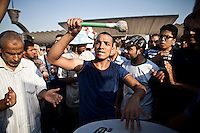Un joueur de tambour pendant une marche des pro Morsi.<br /> <br /> A drum player during a marche of Pro Morsi.