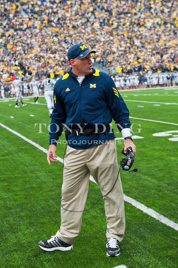 Michigan head coach Rich Rodriguez shouts at his bench on the sidelines in the fourth quarter of an NCAA college football game with Connecticut, Saturday, Sept. 4, 2010, in Ann Arbor. Michigan won 30-10. (AP Photo/Tony Ding)