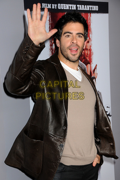 "ELI ROTH .""Inglourious Basterds"" DVD Blu-Ray Release held at the New Beverly Cinema, Los Angeles, California, USA, 14th December 2009..half length hand waving grey gray brown leather jacket  beard facial hair sweater jumper v-neck .CAP/ADM/BP.©Byron Purvis/AdMedia/Capital Pictures."