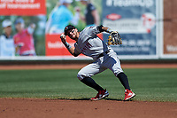 Wisconsin Timber Rattlers second baseman Brice Turang (2) throws to first base during a Midwest League game against the Great Lakes Loons at Dow Diamond on May 4, 2019 in Midland, Michigan. Great Lakes defeated Wisconsin 5-1. (Zachary Lucy/Four Seam Images)