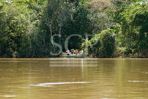 Xingu Indigenous Park, Mato Grosso State, Brazil. Fishermen now have to use fishing lines because the water is so cloudy that they can not see the fish to use bows and arrows.