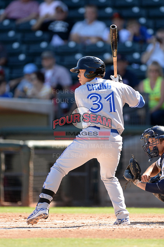 Salt River Rafters catcher Derrick Chung (31), of the Toronto Blue Jays organization, during an Arizona Fall League game against the Surprise Saguaros on October 14, 2013 at Surprise Stadium in Surprise, Arizona.  Salt River defeated Surprise 3-2.  (Mike Janes/Four Seam Images)