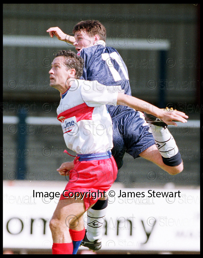 29th August 98      .Copyright Pic : James Stewart   .FALKIRK V STRANRAER.GARETH HUTCHISON OUTJUMPS IAN HARTY.......Payments to :-.James Stewart Photo Agency, Stewart House, Stewart Road, Falkirk. FK2 7AS      Vat Reg No. 607 6932 25.Office : 01324 630007        Mobile : 0421 416997.If you require further information then contact Jim Stewart on any of the numbers above.........