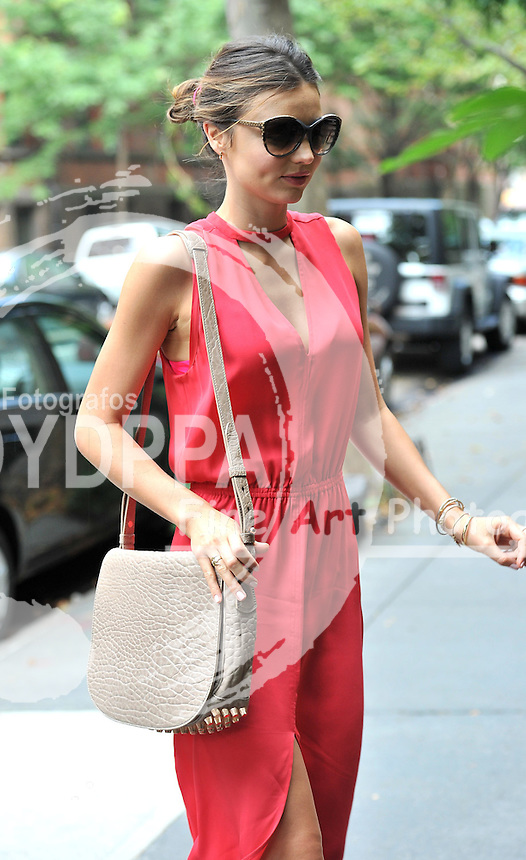 North America Sales Only- NEW YORK, NY<br /> <br /> -PICTURED: MIRANDA KERR, FLYNN<br /> -PHOTO by: JMG/STARTRAKCS PHOTO<br /> -EAGLE-MIRANDA-RED-DRESS-180712-09<br /> Startraks Photo<br /> New York, NY<br /> For licensing please call 212-414-9464 or email sales@startraksphoto.com