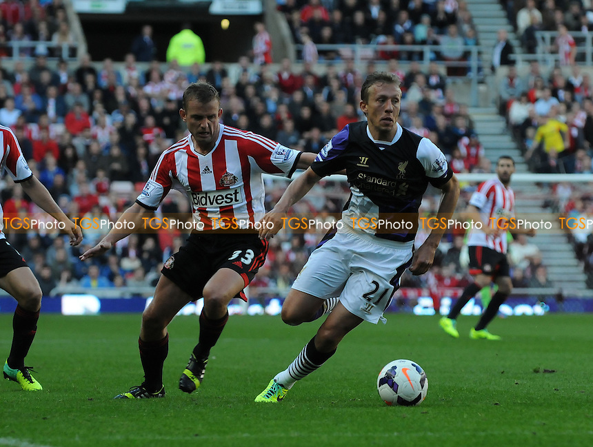 Lucas Leiva of Liverpool battles with Lee Cattermole of Sunderland - Sunderland vs Liverpool - Barclays Premier League Football at the Stadium of Light, Sunderland - 29/09/13 - MANDATORY CREDIT: Steven White/TGSPHOTO - Self billing applies where appropriate - 0845 094 6026 - contact@tgsphoto.co.uk - NO UNPAID USE<br />   i