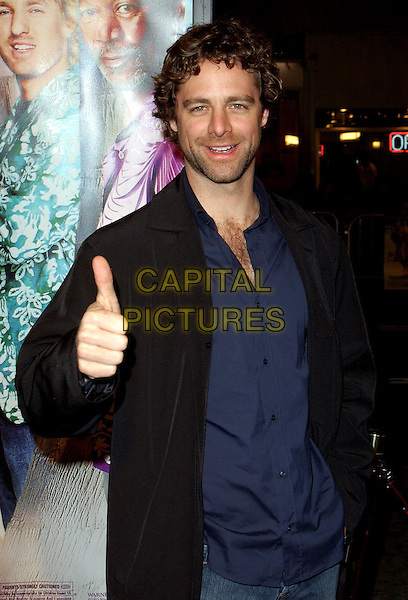 DAVID SUTCLIFFE.The Big Bounce world premiere held at The Mann Village Theatre in Westwood, California.29 January 2004        .*UK Sales Only*      .half length, half-length thumbs up                                                     .www.capitalpictures.com.sales@capitalpictures.com.©Capital Pictures.