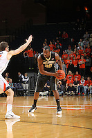 Wake Forest forward Travis McKie (30) handles the ball during the game against Virginia Wednesday Jan. 08, 2014 in Charlottesville, Va. Virginia defeated Wake Forest 74-51.