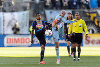 Jose Kleberson (19) of the Philadelphia Union and Aurelien Collin (78) of Sporting Kansas City look to play the ball during a Major League Soccer (MLS) match at PPL Park in Chester, PA, on October 26, 2013.