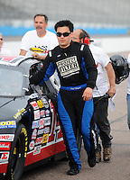Apr 16, 2009; Avondale, AZ, USA; NASCAR Camping World Series West driver Phil Dugan prior to the Jimmie Johnson Foundation 150 at Phoenix International Raceway. Mandatory Credit: Mark J. Rebilas-