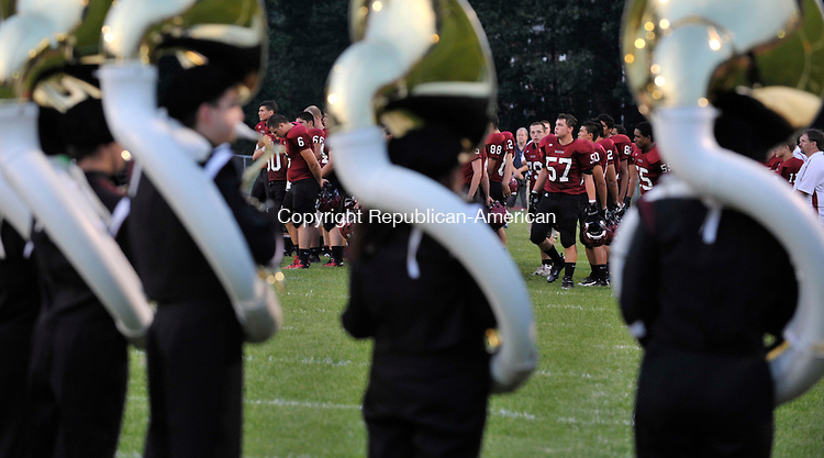TORRINGTON, CT - 14 September 2012-091412EC09--   Torrington's players walk out onto the field with an introduction by the school's marching band Friday night.  The chargers defeated the red raiders 66-26 in Torrington.  Erin Covey Republican-American.