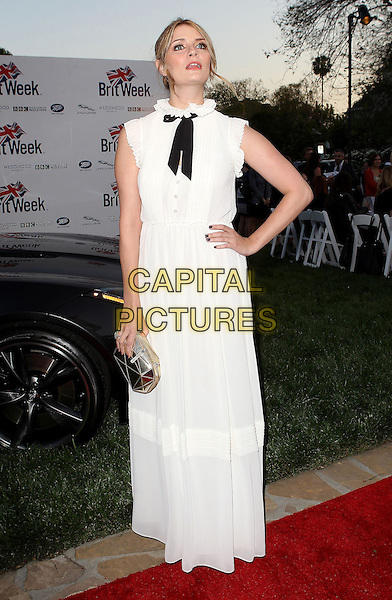 "Mischa Barton.7th Annual BritWeek Festival ""A Salute To Old Hollywood"" Launch Party held at the British Consul General's Residence, Los Angeles, California, USA..April 23rd, 2013.full length black bow white dress maxi sleeveless hand on hip silver clutch bag pussybow .CAP/ADM/KB.©Kevan Brooks/AdMedia/Capital Pictures"