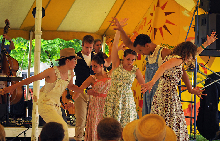 """Members of the Vanaver Caravan Dance troupe, performing,  """"Pastures of Plenty: Tribute to Woody Guthrie"""" on the Dance Stage of the 2012 Clearwater Festival at Croton Point Park on Sunday, June 17, 2012. Photograph taken by Jim Peppler. Copyright Jim Peppler/2012."""