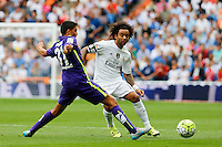 Real Madrid's Brazilian defense Marcelo and Malaga´s Pablo