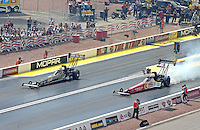 Apr. 7, 2013; Las Vegas, NV, USA: NHRA top fuel dragster driver Brittany Force (left) defeats Doug Kalitta for her first career top fuel round victory during the Summitracing.com Nationals at the Strip at Las Vegas Motor Speedway. Mandatory Credit: Mark J. Rebilas-