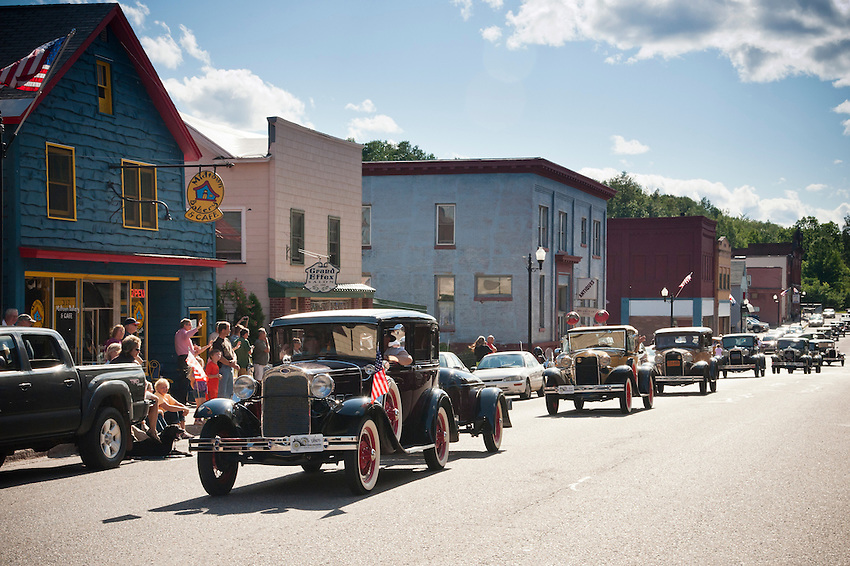 Model A Fords parade through downtown Negaunee, Michigan during the National Model A Convention.