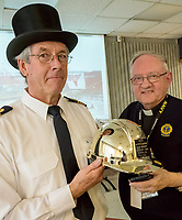 A traditional top hat was presented to the captain of the Iver Bright, of the Netherlands, a asphalt/bituman tanker for being the first salt water vessel to arrive in the port of Sarnia this year. Captain Rene' Van Quekelberghe  received the hat from Mission to Seafarers, St. Clair Region, president Rev. Gordon Simmon. The Arctic ice class tanker was commissioned by Suncor to transport asphalt flux to destinations around the Great Lakes this winter. Although the Iver Bright has been in Sarnia since December hauling cargo, the Mission decided to present the hat since it was the salt water ship to arrive in Sarnia in the New Year.  A ceremony was held at the Suncor administration office.
