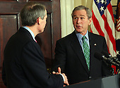 United States President George W. Bush shakes hands with United States Representative Rob Portman (Republican of the 2nd District of Ohio) after announcing his nomination United States Trade Representative in the Roosevelt Room of the White House in Washington, D.C. on March 17, 2005.   <br /> Credit: Roger Wollenberg - Pool via CNP