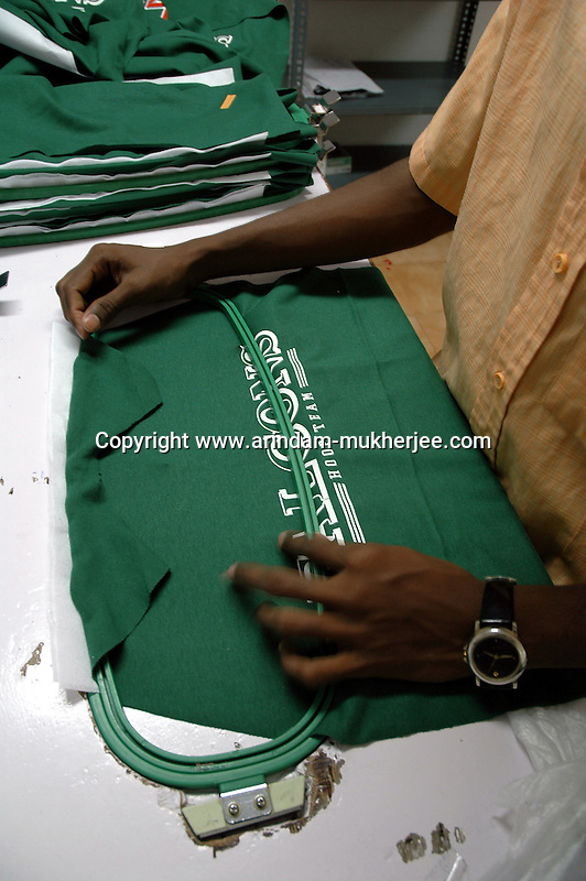 Cloth being fitted to a frame for embroidery at Prime Tex factory in Tirupur . After lifting of quota system in textile export on 1st january 2005. Tirupur has become the biggest foreign currency earning town of India.